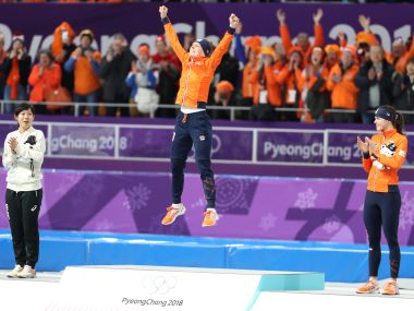 Ireen Wust of the Netherlands celebrates on the podium after winning gold in women's 1,500m. Reuters