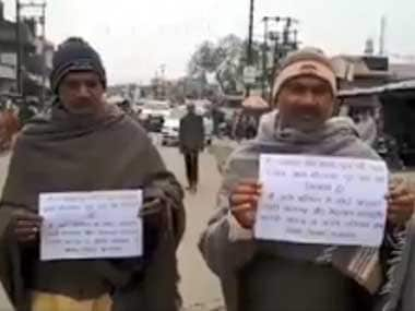 Former Uttar Pradesh prisoners walk with placards pledging to reform and not 'indulge in crime again'