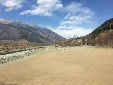 People keep gazing at a barren mountain that used to remain covered by snow in the winter and spring. Firstpost/ Aijaz Nazir
