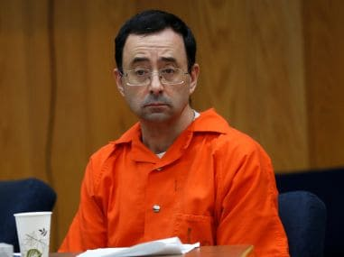 Larry Nassar listens to victims impact statements during his sentencing. Reuters