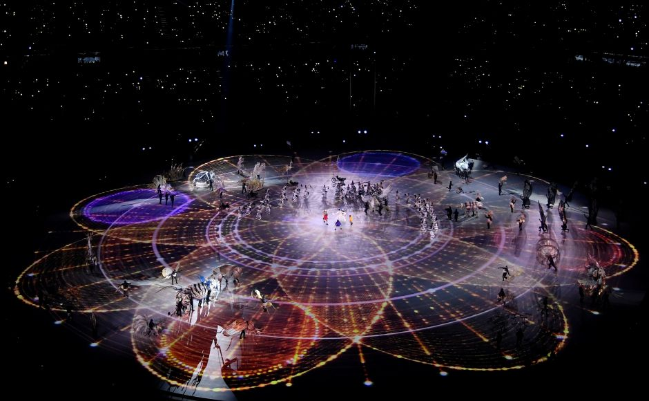 A general view of performers during the opening ceremony. The opening ceremony followed the story line of children wandering through a mythical landscape and discovering a world where people live in peace and harmony. Reuters