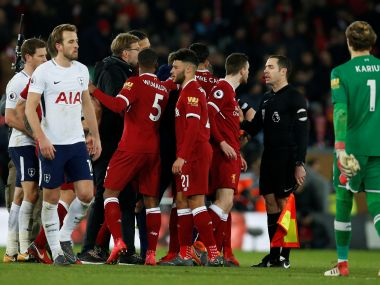 Liverpool players, staff argue with the linesman after the match. Reuters