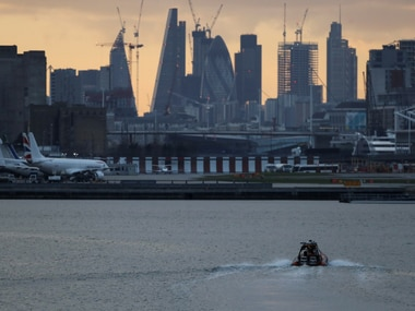 A bomb disposal team approach London City Airport, in London,  on Tuesday. Reuters