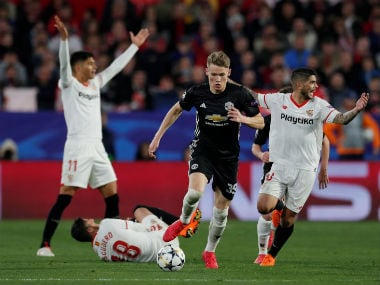 Manchester United's Scott McTominay is in action while Sevilla's Ever Banega and Joaquin Correa react as Sergio Escudero is on the floor. Reuters