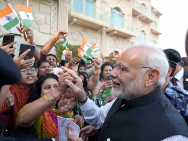 Muscat: Prime Minister Narendra Modi meets Indian community people who enthusiastically welcomed him in  Muscat, Oman on Sunday.   PTI Photo/PIB (PTI2_11_2018_000249B)