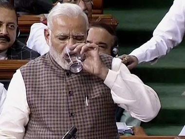 Prime Minister Narendra Modi takes a break while speaking in the Lok Sabha in New Delhi on Wednesday. PTI