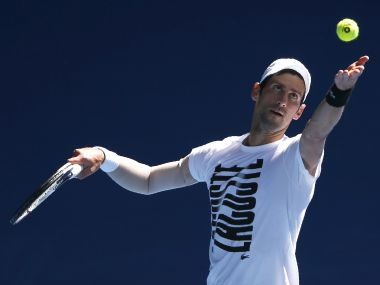 File photo of Novak Djokovic serving during a practice session before the Australian Open. Reuters