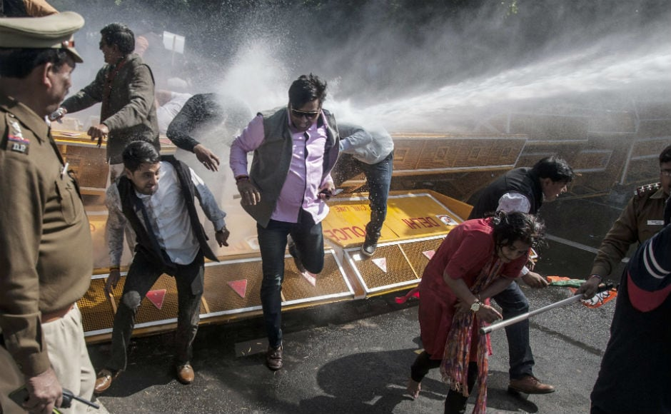 The BJP staged a protest outside Kejriwal's residence accusing his government of pushing the city 30 years behind in three years of its rule. The Delhi Police use mild force and water cannons, injuring several BJP workers.