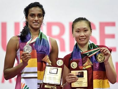 New Delhi: India's P V Sindhu and Beiwen Zhang (USA) pose for a picture with their medals after the women singles final match of the Yonex-Sunrise India Open 2018 in New Delhi on Sunday. Beiwen Zhang (USA) won the match by 21-18,11 -21, 22 - 20 . PTI Photo by Arun Sharma(PTI2_4_2018_000187B) *** Local Caption ***