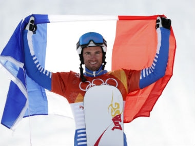 Gold medallist Pierre Vaultier of France carries the French flag as he celebrates. Reuters