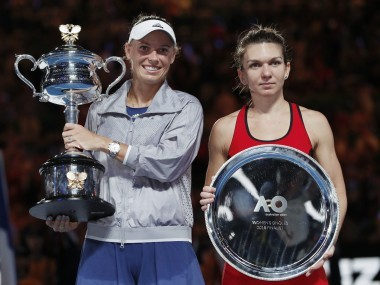 Caroline Wozniacki and Simona Halep with their trophies after the Australian Open final. Reuters