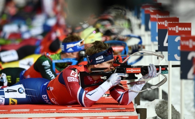 Biathletes shooting in the prone position during the Biathlon World Cup in 2017. Reuters