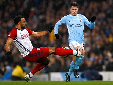 """Soccer Football - Premier League - Manchester City vs West Bromwich Albion - Etihad Stadium, Manchester, Britain - January 31, 2018 Manchester City's Brahim Diaz in action with West Bromwich Albion's Matt Phillips Action Images via Reuters/Jason Cairnduff EDITORIAL USE ONLY. No use with unauthorized audio, video, data, fixture lists, club/league logos or """"live"""" services. Online in-match use limited to 75 images, no video emulation. No use in betting, games or single club/league/player publications. Please contact your account representative for further details. - RC1898381EA0"""