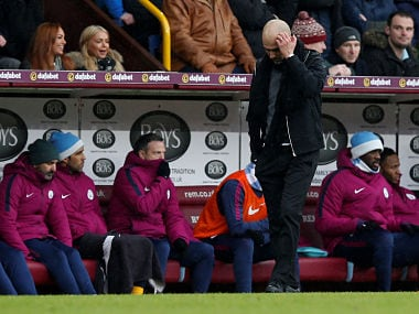 """Soccer Football - Premier League - Burnley vs Manchester City - Turf Moor, Burnley, Britain - February 3, 2018 Manchester City manager Pep Guardiola looks on REUTERS/Andrew Yates EDITORIAL USE ONLY. No use with unauthorized audio, video, data, fixture lists, club/league logos or """"live"""" services. Online in-match use limited to 75 images, no video emulation. No use in betting, games or single club/league/player publications. Please contact your account representative for further details. - RC15FF9A3890"""