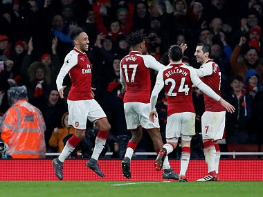 """Soccer Football - Premier League - Arsenal vs Everton - Emirates Stadium, London, Britain - February 3, 2018 Arsenal's Pierre-Emerick Aubameyang celebrates scoring their fourth goal with teammates REUTERS/David Klein EDITORIAL USE ONLY. No use with unauthorized audio, video, data, fixture lists, club/league logos or """"live"""" services. Online in-match use limited to 75 images, no video emulation. No use in betting, games or single club/league/player publications. Please contact your account representative for further details. - RC1160F43D10"""