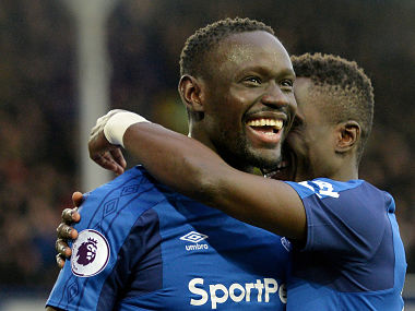 """Soccer Football - Premier League - Everton vs Crystal Palace - Goodison Park, Liverpool, Britain - February 10, 2018 Everton's Oumar Niasse celebrates scoring their second goal with Idrissa Gueye REUTERS/Peter Powell EDITORIAL USE ONLY. No use with unauthorized audio, video, data, fixture lists, club/league logos or """"live"""" services. Online in-match use limited to 75 images, no video emulation. No use in betting, games or single club/league/player publications. Please contact your account representative for further details. - RC19C6792A30"""