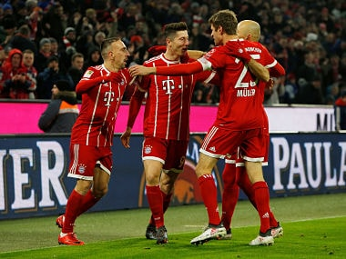 Soccer Football - Bundesliga - Bayern Munich vs Schalke 04 - Allianz Arena, Munich, Germany - February 10, 2018 Bayern Munich's Robert Lewandowski celebrates scoring their first goal with Franck Ribery, Thomas Muller and Arjen Robben REUTERS/Michaela Rehle DFL RULES TO LIMIT THE ONLINE USAGE DURING MATCH TIME TO 15 PICTURES PER GAME. IMAGE SEQUENCES TO SIMULATE VIDEO IS NOT ALLOWED AT ANY TIME. FOR FURTHER QUERIES PLEASE CONTACT DFL DIRECTLY AT + 49 69 650050 - RC1CE54B3DB0