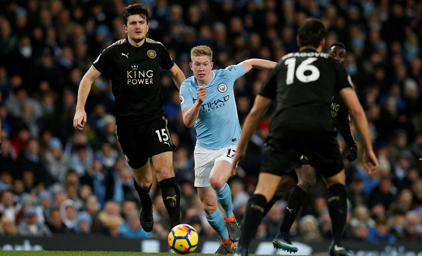 """Soccer Football - Premier League - Manchester City vs Leicester City - Etihad Stadium, Manchester, Britain - February 10, 2018 Manchester City's Kevin De Bruyne in action with Leicester City's Harry Maguire REUTERS/Andrew Yates EDITORIAL USE ONLY. No use with unauthorized audio, video, data, fixture lists, club/league logos or """"live"""" services. Online in-match use limited to 75 images, no video emulation. No use in betting, games or single club/league/player publications. Please contact your account representative for further details. - RC13E0960240"""