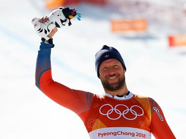 Alpine Skiing – Pyeongchang 2018 Winter Olympics – Men's Downhill – Jeongseon Alpine Centre - Pyeongchang, South Korea – February 15, 2018 - Aksel Lund Svindal of Norway reacts during the victory ceremony. REUTERS/Leonhard Foeger - DEVEE2F0COZHK