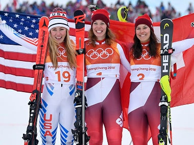 Alpine Skiing - Pyeongchang 2018 Winter Olympics - Women's Alpine Combined - Jeongseon Alpine Centre - Pyeongchang, South Korea - February 22, 2018 - Silver medallist Mikaela Shiffrin of the U.S., gold medallist Michelle Gisin of Switzerland and bronze medallist Wendy Holdener of Switzerland celebrate during the victory ceremony. REUTERS/Toby Melville - DEVEE2M0KBZHK