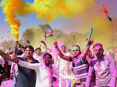 Congress workers celebrate with colours the party's win in Rajasthan bypolls. PTI