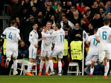 Real Madrid's Cristiano Ronaldo celebrates scoring their second goal with teammates. Reuters