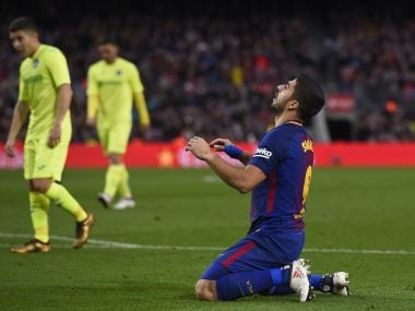 Barcelona's Luis Suarez kneels on the field during the match against Getafe. AFP