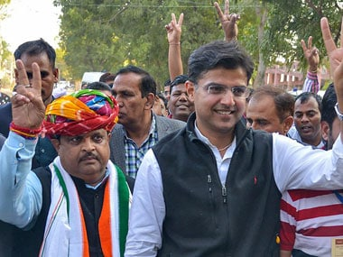 Rajasthan Congress chief Sachin Pilot and Congress candidate Raghu Sharma flash victory sign after latter's victory in Ajmer By-poll election, in Ajmer on Thursday. PTI