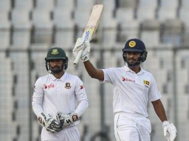 Sri Lanka's Roshen Silva reacts after scoring a half century against Bangladesh on Day 2. AFP