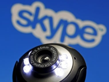 A web camera is seen in front of a Skype logo. Image: Reuters