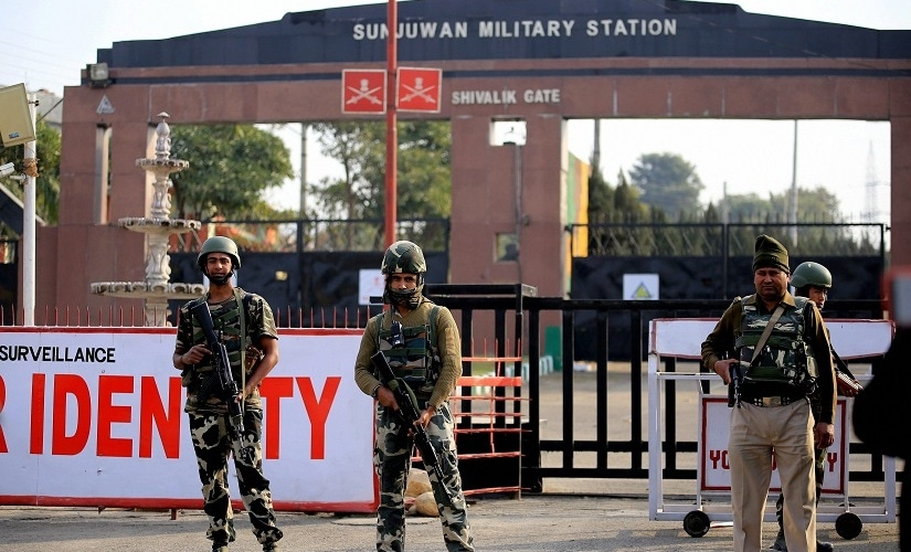 Security personnel takes positions at Sunjuwan Army camp in Jammu. PTI