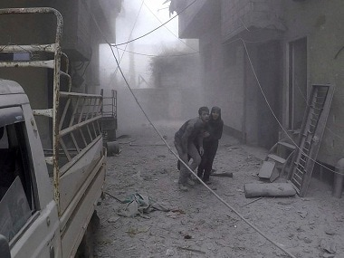 Syria bombardment kills 77 civilians in Eastern Ghouta as regime forces prepare for ground assault