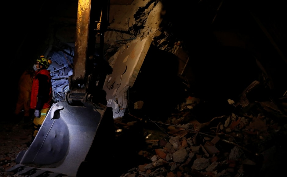 Rescue workers scrambled to search for survivors in buildings left tilting precariously on their foundations in the Taiwanese city of Hualien on Wednesday, after an overnight earthquake killed four and injured more than 200. Reuters