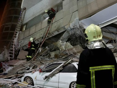 Emergency services at work after the earthquake brought down several buildings in coastal Taiwan. Reuters