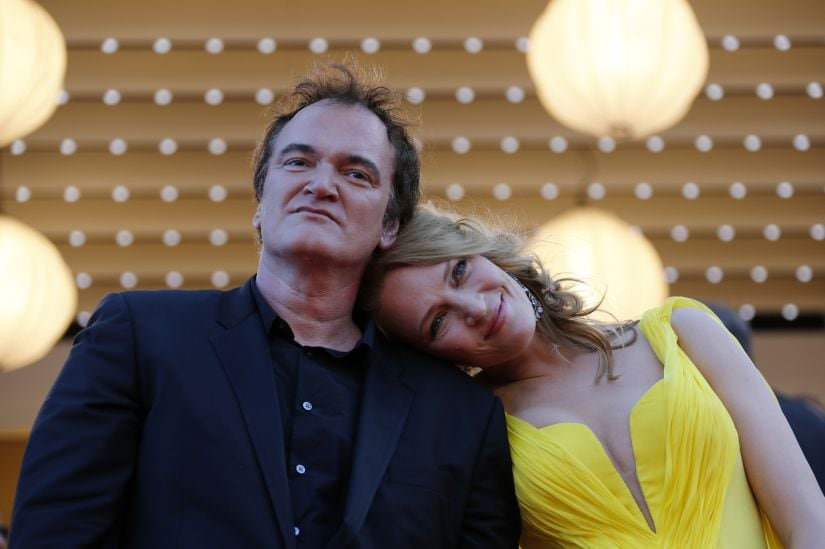 """Director Quentin Tarantino (L) and actress Uma Thurman pose on the red carpet they arrive for the screening of the film """"Sils Maria"""" (Clouds of Sils Maria) in competition at the 67th Cannes Film Festival in Cannes May 23, 2014. The film """"Pulp Fiction"""" will be presented on Friday during a beach front cinema screening for its 20th anniversary. REUTERS/Regis Duvignau (FRANCE - Tags: ENTERTAINMENT TPX IMAGES OF THE DAY) - LR2EA5N1FXFLY"""