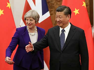 Chinese President Xi Jinping and British Prime Minister Theresa May gesture ahead of a meeting at the Diaoyutai State Guesthouse in Beijing, China. Reuters