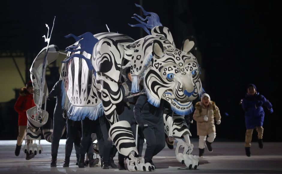 Artists perform during the opening ceremony.Some of the animals honored with puppets in the opening ceremony included a white tiger (the 2018 Olympics mascot), a grasshopper, a dragon, and a turtle. Reuters