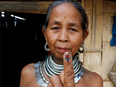 A tribal woman shows her ink-marked finger after casting vote for Tripura Assembly elections on the outskirts of Agartala. PTI