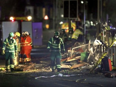 Emergency personnel attend the scene of an incident in Leicester, central England. AP