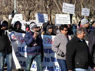 Hundred highly-skilled Indian workers hold a rally to end the per-country limit on legal permanent residency so as to eliminate the massive Green Card backlog, in front of the White House in Washington, DC on Saturday. PTI