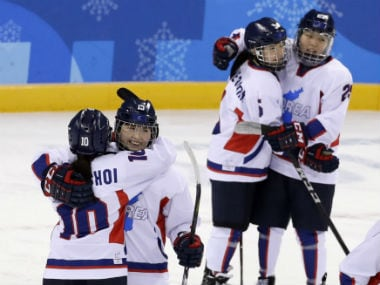 Members of the joint Korean women's ice hockey team embrace each other after bowing out of the Olympics. Reuters