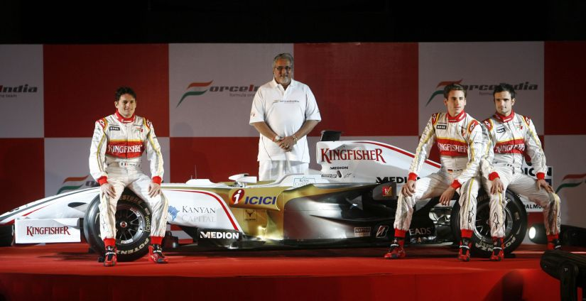 File photo of Force India's Formula One team drivers Giancarlo Fisichella (L), Adrian Sutil (2nd R) and Vitantonio Liuzzi and team chairman Vijay Mallya (C) during the team's launch in 2008. Reuters