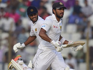 Sri Lanka cricket captain Dinesh Chandimal and Roshen Silva run between the wickets during the third day of first Test against Bangladesh. AFP