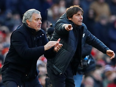 Manchester United manager Jose Mourinho and Chelsea manager Antonio Conte react during the match. Reuters