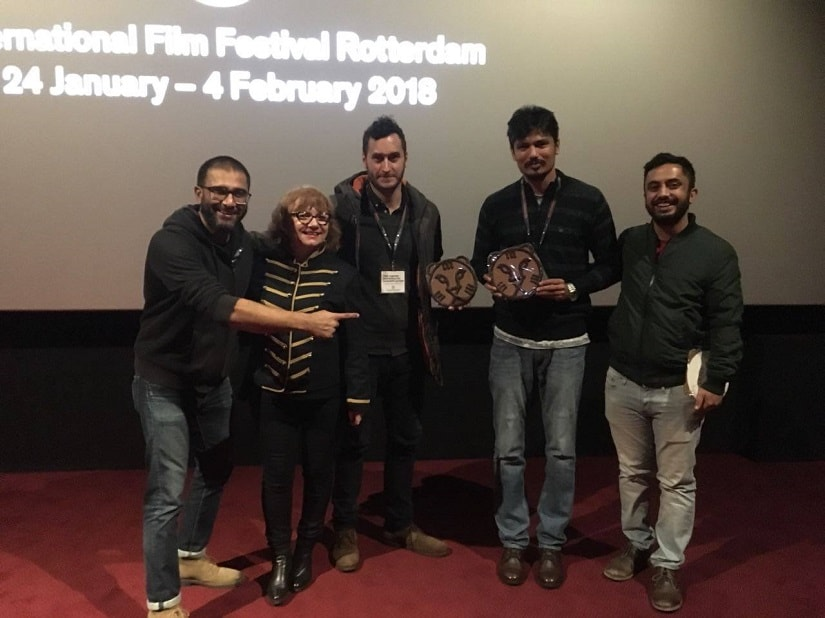Ere Gowda receives the award at the IFFR. Image from Facebook/Ere Gowda