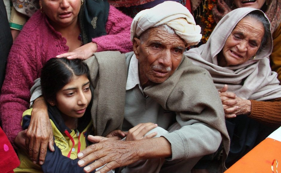 Daughter and father of Lal, who was killed along the LoC in the shelling from Pakistan side on Sunday. The others who lost their lives were Riflemen Ramavatar, 27, from Baraka village in Madhya Pradesh's Gwalior and Subham Singh, 23 from Jammu and Kashmir's Kathua. PTI