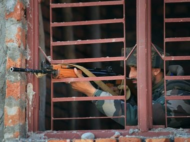 A security personnel during the terror attack at  Sunjwan. PTI