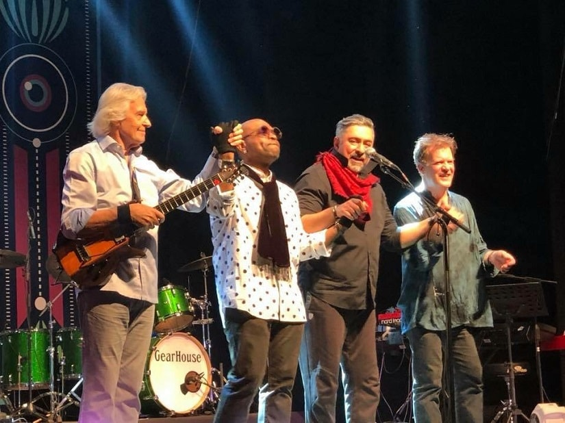 John McLaughlin, Etienne M'Bappe, Ranjit Barot and Gary Husband on stage. Photo by Pankaj Kehr via Twitter/@GHusband