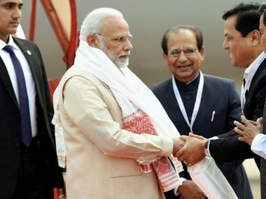 Prime Minister Narendra Modi receives welcome by Assam Chief Minister Sarbananda Sonowal and Governor Jagdish Mukhi on his arrival in Guwahati on Saturday. PTI