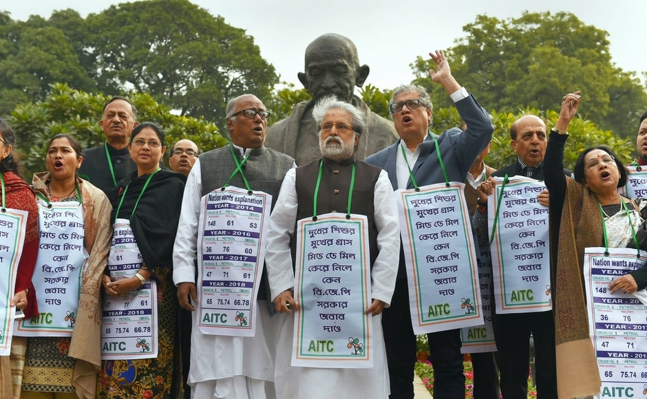 TMC members held protest against price hike in diesel and petrol in the Budget Session outside the Parliament on Tuesday. The Rajya Sabha was adjourned twice till late afternoon due to protests by Opposition members including those from the Congress and the TMC, who alleged that their voice was being
